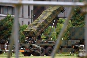 Japanese Self-Defence Force Patriot Advanced Capability-3 (PAC-3) missile interceptor is deployed outside the Defence Ministry headquarters in Tokyo, on Aug 11, 2017.