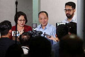 (From left) Workers' Party chairman Sylvia Lim, chief Low Thia Khiang and assistant secretary-general Pritam Singh holding a media doorstop interview on July 26, 2017.