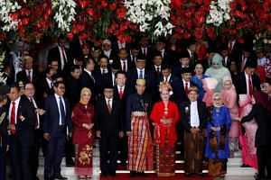 Indonesia president Joko Widodo (centre) and his wife Iriana pose for pictures with parliament members after delivering a speech in front of parliament members ahead of Thursday's independence day in Jakarta, Indonesia on Aug 16, 2017.