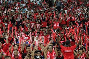 Singapore fans cheering on the Lions during match against Malaysia at the Causeway Challenge at National Stadium on Oct 7, 2016.