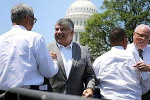 AFL-CIO President Richard Trumka (second from left) resigned from Donald Trump's council on manufacturing on Tuesday after the US president's response to violent white supremacists in Charlottesville.