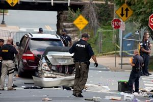 Virginia State Police inspect the site where a vehicle hit protesters in Charlottesville, Virginia.