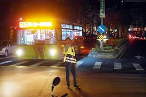 A policeman directs traffic during a power outage in Taipei, Taiwan, on Aug 15, 2017.