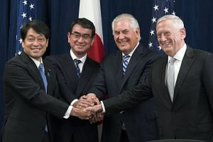 (From left) Japan's Itsunori Onodera and Taro Kono shake hands with the US' Rex Tillerson and James Mattis.