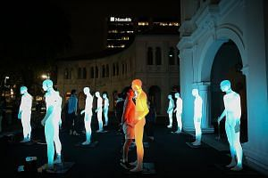 Another exhibit at the festival is Flock, an interactive light installation which turns the spotlight on pedestrians, co-opting them into the performance. Visitors can interact with 16 human-sized figures at the Les Hommes Debout (The Standing Men) e