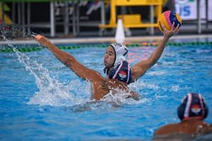Indonesia's Benny Respati tries to block a shot from Singapore's Chiam Kun Yang (white cap) during the SEA Games men's water polo match between both countries, on Aug 18, 2017.