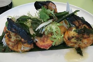 Masala prawns paired with sweet coconut-chilli dressing.