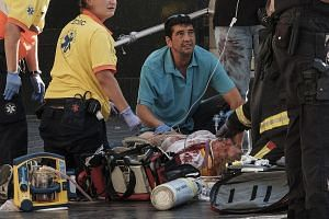 Paramedics attending to one of the many pedestrians struck by a van that ploughed into crowds in Las Ramblas, Barcelona's most famous street, on Thursday. At least 13 people were killed and 130 injured in the terror attack, which residents had long f