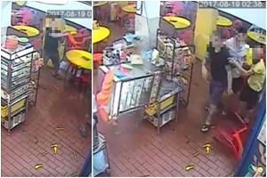The customer (in black) was seen in a video hurling utensils and a chair before knocking down a bun steamer at the restaurant.