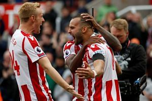 Stoke City's Jese Rodriguez celebrates scoring their first goal with Darren Fletcher.