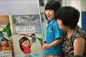 A pupil learning Chinese through a story set in Singapore, at an MOE kindergarten.