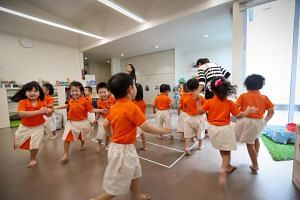Children enjoying themselves during a class activity at an NTUC My First Skool.