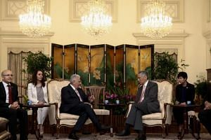 Turkish Prime Minister Binali Yildirim (centre, left) with Singapore's Prime Minister Lee Hsien Loong at the Istana Presidential Palace in Singapore on Aug 21, 2017.