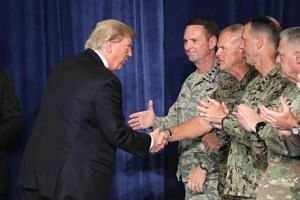 US President Donald J. Trump (left) greets military leaders before his speech on Afghanistan at the Fort Myer military base in Arlington, Virginia, USA on Aug 21, 2017.