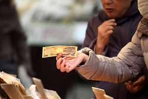 Many Japanese still prefer to carry wads of cash around, given Japan's low crime rate. This is despite cashless payment options being accepted by businesses such as convenience stores.