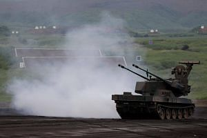 A Japanese Ground Self-Defence Force Type 87 self-propelled anti-aircraft gun participating in an annual training session in Gotemba on Aug 24, 2017.