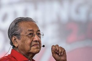Malaysian Prime Minister Mahathir Mohamad delivering his speech during a forum in Shah Alam, on the outskirts of Kuala Lumpur.