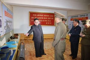 This undated picture released by North Korea's official Korean Central News Agency (KCNA) on Aug 23, 2017 shows North Korean leader Kim Jong Un visiting the Chemical Material Institute of the Academy of Defense Science at an undisclosed location. Mis