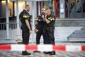Police officers on guard during the evacuation of the Rotterdam concert venue.