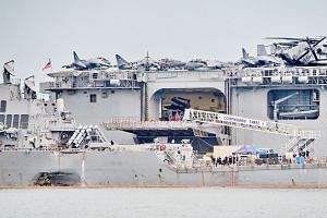 The guided-missile destroyer USS John S. McCain, with a hole on its hull, berthed at Changi Naval Base after Monday's collision. A string of US Navy accidents has raised doubts about its operations, reiterating worries about