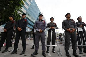 Thai police officers stand guard in front of the Supreme Court's Criminal Division for Persons Holding Political Positions in Bangkok.