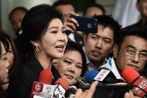Former Thai prime minister Yingluck Shinawatra speaking to the media after leaving the Supreme Court in Bangkok last month. The kingdom's first female prime minister could be jailed for up to 10 years if found guilty of criminal negligence for failin