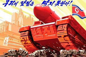 A propaganda poster blaming the US and other hostile countries' sanction is seen in this undated photo released by North Korea's Korean Central News Agency (KCNA) in Pyongyang.