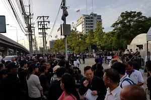 Hundreds of supporters of former Thai prime minister Yingluck Shinawatra gathering outside the Supreme Court in Bangkok.