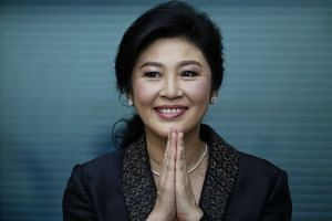 Former Thai prime minister Yingluck Shinawatra greets supporters as she arrives to deliver closing statements in her trial at the Supreme Court's Criminal Division for Persons Holding Political Positions in Bangkok, Thailand on Aug 1, 2017.