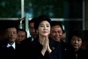 Ousted former Thai prime minister Yingluck Shinawatra greets supporters as she arrives at the Supreme Court in Bangkok, Thailand on July 21, 2017.