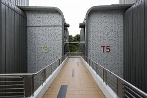 Cladding on T3 and T5 of Singapore Polytechnic on Aug 24, 2017.