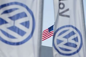 An American flag flies next to a Volkswagen car dealership in San Diego, California.