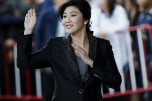 Former Thai prime minister Yingluck Shinawatra waving to supporters as she arrives to deliver closing statements in her trial at the Supreme Court's Criminal Division for Persons Holding Political Positions in Bangkok, Thailand, on Aug 1, 2017.
