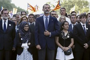 King Felipe VI (centre) at the march, with Spanish PM Mariano Rajoy (left) and others.