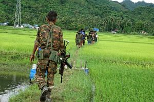 Myanmar soldiers in ChainKharLi Rakhine ethnic village, an area close to the fighting at Rathedaung township of Rakhine state in Myanmar on Friday. The death toll from attacks by Rohingya insurgents that day has climbed to 96, the government said. In