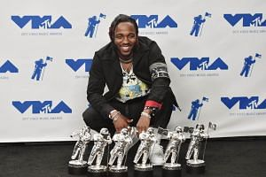 Kendrick Lamar, winner of Video of the Year, Best Hip Hop, Best Cinematography, Best Direction, Best Art Direction, Best Visual Effects for 'Humble', poses in the press room during the 2017 MTV Video Music Awards, on Aug 27, 2017.