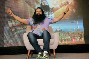 India's self-styled guru and spiritual leader Gurmeet Ram Rahim Singh poses prior to the release of his film MSG Messenger Of God II in New Delhi on Sept 14, 2015.