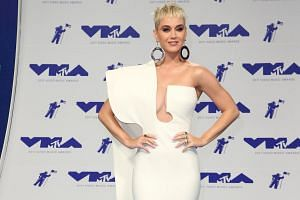 Singer Katy Perry arrives on the red carpet for the 34th MTV Video Music Awards (VMA) at The Forum in Inglewood, on Aug 27, 2017.