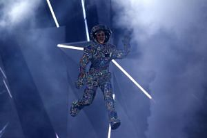 Show host Katy Perry dangles above the stage at the 2017 MTV Videos Music Awards in Inglewood, California, on Aug 27, 2017.