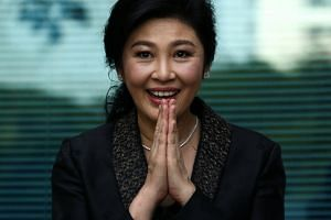 Ousted former Thai prime minister Yingluck Shinawatra greets supporters as she arrives at the Supreme Court in Bangkok, on Aug 1, 2017.