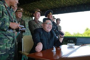 North Korean leader Kim Jong Un guides a target-striking contest of the special operation forces of the Korean People's Army (KPA) to occupy islands in Pyongyang on Aug 25, 2017.