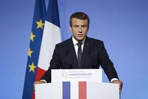 French President Emmanuel Macron addresses French ambassadors during the annual gathering of French diplomatic corps at the Elysee Palace in Paris, on Aug 29, 2017.