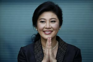 Former Thai prime minister Yingluck Shinawatra greets supporters as she arrives to deliver closing statements in her trial at the Supreme Court's Criminal Division for Persons Holding Political Positions in Bangkok, Thailand, on Aug 1, 2017.