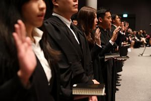 Newly-appointed lawyers taking the oath during the first session of Mass Call 2017.