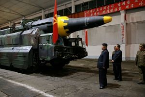 North Korean leader Kim Jong Un inspects a Hwasong-12 rocket in a file photo.