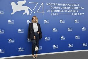 Italian actress Greta Scarano, member of the jury for the Luigi de Laurentiis Venice award for a debut film attends a photocall during the 74th Venice Film Festival on Aug 30, 2017 at Venice Lido.