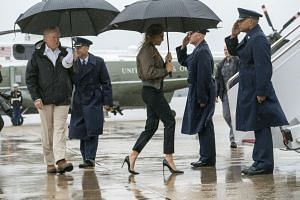 Donald and Melania Trump board Air Force One for a trip to Texas, Aug 29, 2017.
