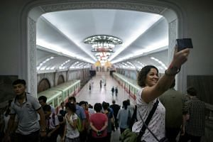 A tourist takes a selfie during a visit to a subway station in Pyongyang on July 23, 2017.