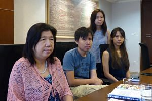 Pastor Raymond Koh's family members (from right) wife Susanna Liew, son Jonathan, and daughters Elizabeth and Ester are clinging on to hope that their patriarch is safe. Mr Koh went missing on Feb 13, 2017.
