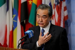 Wang Yi, Chinese Minister for Foreign Affairs, speaks before a meeting of the Security Council inside of United Nations (UN) headquarters in New York, on April 28, 2017.